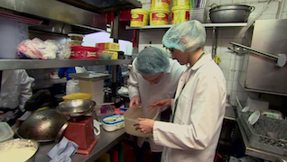 Food inspectors check the kitchen of a restaurant which is listed on Deliveroo